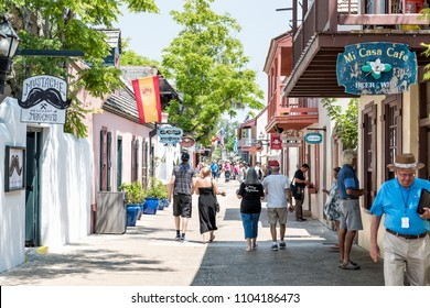 St. Augustine, USA - May 10, 2018: St George Street stores in downtown Florida city famous historic Spanish city, sunny day summer, people tourists walking
