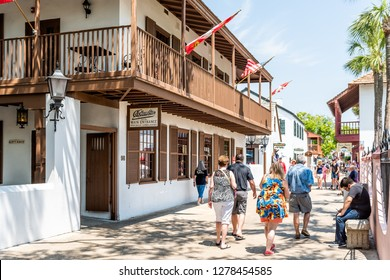 St. Augustine, USA - May 10, 2018: St George Street and people walking on sunny day by famous restaurants and stores in downtown old town Florida city