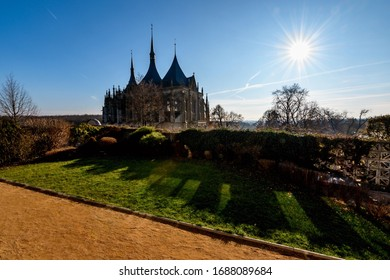 St. Barbara's Church in Kutna Hora, gothic cathedrale and national cultural landmark in garden with sun rays, Czech republic. - Shutterstock ID 1688089684
