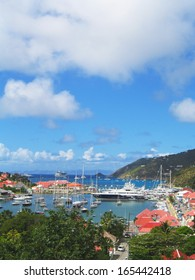 ST BARTS, FRENCH WEST INDIES - JANUARY 19:Aerial view at Gustavia Harbor with mega yachts on January 19, 2005 at St Barts. The island is popular tourist destination during the winter holiday season
