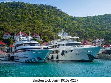 ST BARTS, FRENCH WEST INDIES - FEBRUARY 5, 2021: Mega yachts anchored in Gustavia harbor. It is the capital of Saint Barthelemy, a French-speaking Caribbean island commonly known as St. Barts