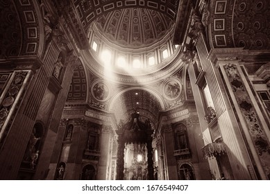 St. Peter's Basilica interior with light beam in Vatican City.