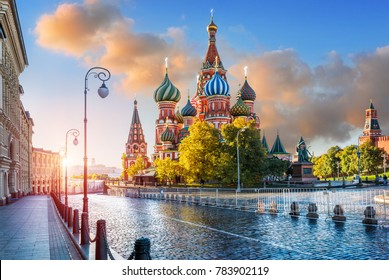 St. Basil's Cathedral with lanterns on Red Square in Moscow in the light of morning sunlight and pink clouds in the sky