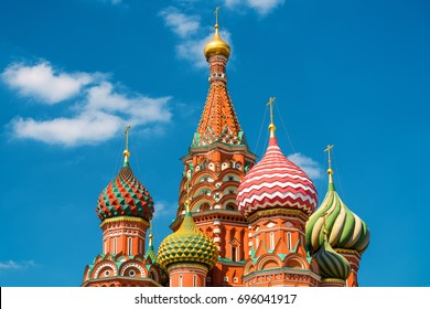 St Basil`s Cathedral on Red Square in Moscow, Russia. St Basil's Cathedral is a symbol of Russian culture. St Basil`s Cathedral on the blue sky background. Vibrant view of St Basil in the sunlight.