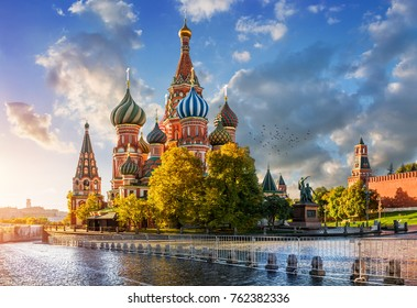 St. Basil's Cathedral on Red Square in Moscow in the light of the morning autumn sun and clouds in the blue sky