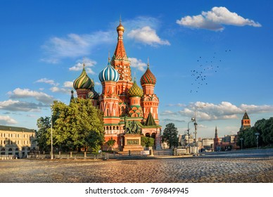St. Basil's Cathedral on Red Square in the Kremlin in Moscow in the light of the evening sun and clouds in the blue sky