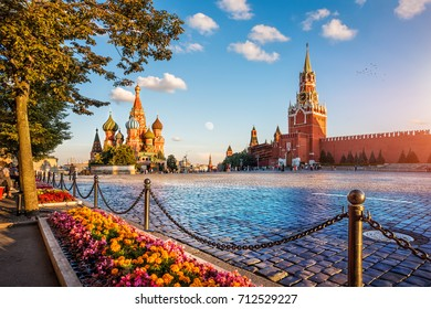 St. Basil's Cathedral and Spassky Tower on Red Square in Moscow on a summer evening and colorful flowers