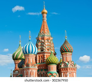 St. Basil's Cathedral in sunny summer day against blue sky with small white clouds. Red square. Moscow. Russia
