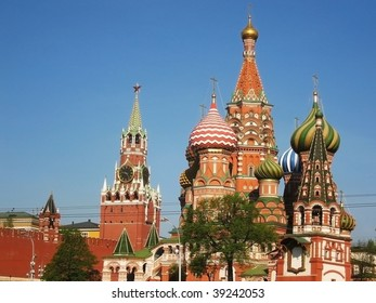 St. Basil's (Pokrovskiy) cathedral in Moscow, Russia, and Spasskaya tower of Kremlin.
