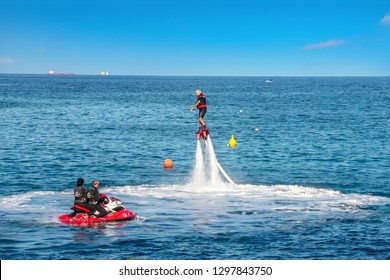 ST JULIAN'S BAY, MALTA - OCTOBER 06, 2014: New popular type of extreme water sport called flyboard at sea. Special board in motion from jet force of water flow by hydrocycle.  Malta island, Europe