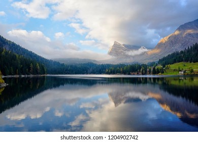 St Bernard lake, Switzerland, Grigioni canton. Sunset light with clouds reflected in the water