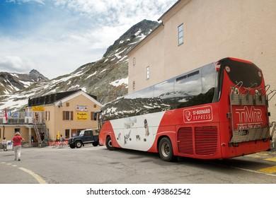 St. Bernard pass, Switzerland - JUL 05, 2016: A touristic bus at cafe on pass of St.Bernard