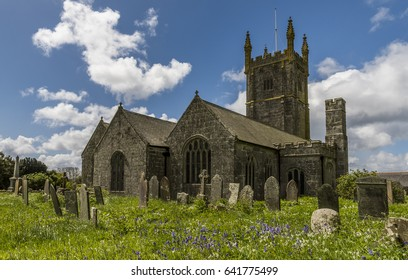 St. Breage, England - April 25, 2017: anChurch of St. Breage with graveyard and gravestones on a spring day.