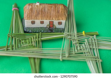 A St. Brigid's cross and traditional Irish thatched cottage. In traditional Ireland, every house would have a St. Brigid's cross hanging on the wall to ward off evil.