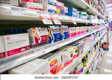 St. Catharines, Ontario / Canada - January 25, 2008: Flu and cold medication displayed at a pharmacy.