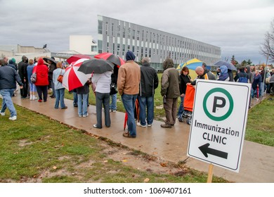 St. Catharines, Ontario, Canada - October 30, 2009: Long lines of people line up for a H1N1 immunization clinic in the Niagara Region.