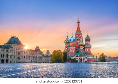 St. Basil's Cathedral on Red Square in Moscow and golden clouds with the first rays of the autumn sun