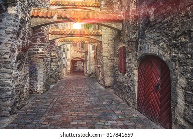 St. Catherine's Passage in Tallinn, Estonia. A sunlight through the window shining at the little walkway in the old city. Lens flares