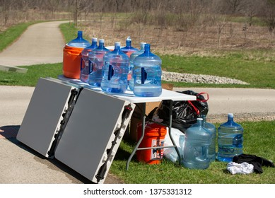 St. Charles, Illinois - April 20th, 2019: A hydration and waste station in the Leroy Oaks Nature Preserve. This was left in place along the route for the Sly Fox Half Madness 10k run.