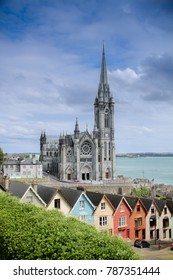 "St Colman's Cathedral, Cobh with ""The Deck of Cards"" (Colorful Houses)"
