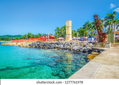 St Croix, Virgin Islands, Caribbean. Frederiksted cruise port with old Fort Frederik and clock tower at the waterfront.