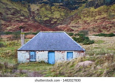 St Cyrus, Aberdeenshire, Scotland - 8th January 2013: An old abandoned Sea Salmon Fishing Bothy situated behind the Dunes on the St Cyrus Coastline in front of the towering Cliffs behind.