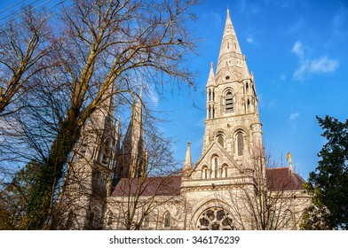 St Fin Barre's cathedral behind the trees in Cork, Ireland