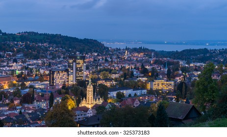 St. Gallen City, Beautiful Night Panorama Aerial View of St. Gallen Cityscape Skyline, Abbey Cathedral of Saint Gall, University of St.Gallen and Kirche St. Laurenzen at Dusk in Autumn, Switzerland