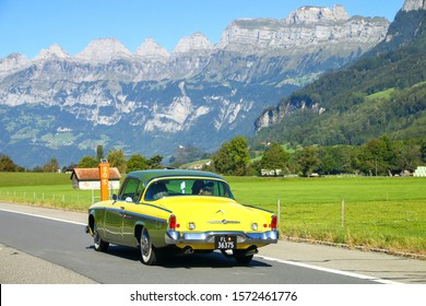St. Gallen, Switzerland - September 21, 2019: Vintage motor car Studebaker Commander at the background of the Alps.