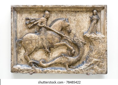 St George and the Dragon bas-relief, flanked by the Dandolo arms. Istrian stone. About 1500. Venice, Italy.