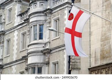 St. George flag on a pylon in City of London, United Kingdom