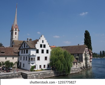 St. George's Abbey at Rhine River in european STEIN am RHEIN town in SWITZERLAND at swiss canton Schaffhausen on alpine landscapes with clear blue sky in 2018 warm sunny summer day on August.