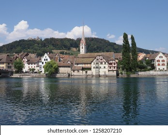 St. George's Abbey at Rhine River at cityscape of european STEIN am RHEIN town in SWITZERLAND at swiss canton Schaffhausen on alpine landscapes, clear blue sky in 2018 warm sunny summer day on August.