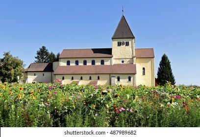 St. George's Church on the Island of Reichenau, Germany with field of wildflowers