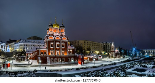 St. George's Church of the Znamensky Monastery and the Chambers of the Romanov boyars in winter snowy night. Zaryadye Park in Moscow, Russia.
