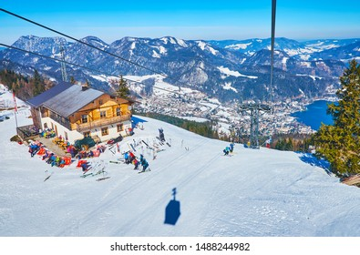 ST GILGEN, AUSTRIA - FEBRUARY 23, 2019: Zwolferhorn cableway is popular tourist attraction in St Gilgen, that boasts a top view on Wolfgangsee lake and spectacular Alps on February 23 in St Gilgen