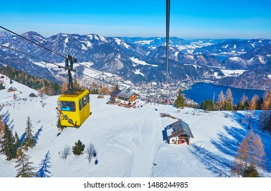 ST GILGEN, AUSTRIA - FEBRUARY 23, 2019: The Zwolferhorn cable car opens the nice view on the rocky Alps, valley with St Gilgen town and Wolfgangsee lake, on February 23 in St Gilgen