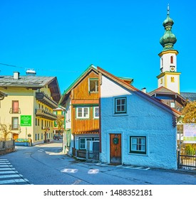 ST GILGEN, AUSTRIA - FEBRUARY 23, 2019: Walk old curved narrow street of St Gilgen and watch its historical buildings, churches and tourist cafes, on February 23 in St Gilgen