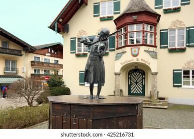 ST. GILGEN, AUSTRIA - FEBRUARY, 25. Statue of Mozart near the Town Hall during a snowfall on February 25, 2016. Alpine village Sankt-Gilgen, Austria.