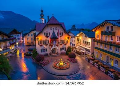 ST. GILGEN, AUSTRIA - JULY 11, 2019: The Rathaus (Town Hall) on Mozartplatz in the Town Centre of Sankt Gilgen village, a populart and well-known travel destination in Salzkammergut region. Night view