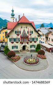 ST. GILGEN, AUSTRIA - JULY 11, 2019: The Rathaus (Town Hall) on Mozartplatz in the Town Centre of Sankt Gilgen village, a populart and well-known travel destination in Salzkammergut region.