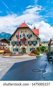 ST. GILGEN, AUSTRIA - JULY 12, 2019: The Rathaus (Town Hall) on Mozartplatz in the Town Centre of Sankt Gilgen village, a populart and well-known travel destination in Salzkammergut region.
