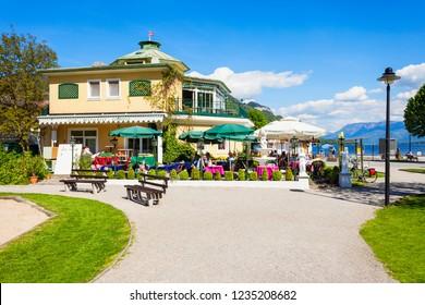 ST. GILGEN, AUSTRIA - MAY 17, 2017: Restaurant and public park in St Gilgen village, Salzkammergut region of Austria. St Gilgen located at Wolfgangsee Lake.
