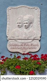 ST. GILGEN, AUSTRIA - SEPTEMBER 19, 2018: Photo of A memorial plaque with a bas-relief that Mozart's mother was born and lived. Mozart House (Mozarthaus).