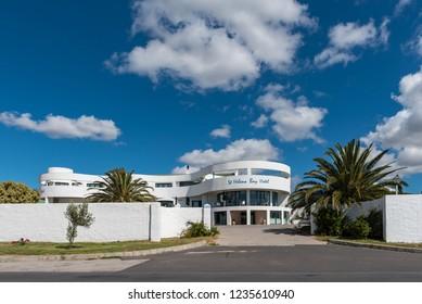 ST HELENA BAY, SOUTH AFRICA, AUGUST 21, 2018: A street scene, with the St. Helena Bay Hotel, in St Helena Bay on the Atlantic Ocean Coast