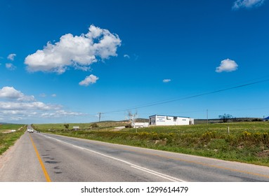 ST HELENA BAY, SOUTH AFRICA, AUGUST 21, 2018: A road landscape, with a butchery and vehicles, near St Helena Bay on the Atlantic Ocean Coast