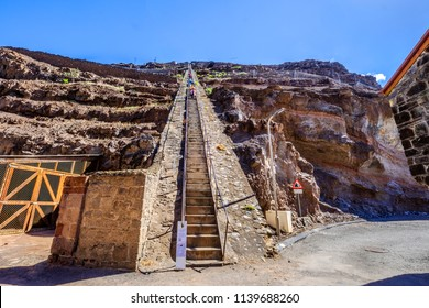 ST HELENA ISLAND, SOUTH ATLANTIC - ARIL 2 2018: Group of tourists on their way down the 699 steep steps of Jacobs Ladder in Jamestown Saint Helena