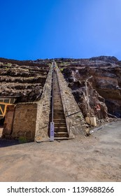 ST HELENA ISLAND, SOUTH ATLANTIC - ARIL 2 2018: Group of tourists climbing down the 699 steep steps of Jacobs Ladder in Jamestown Saint Helena