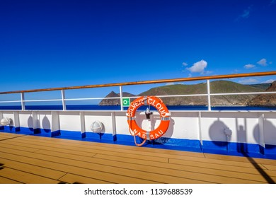 ST HELENA ISLAND, SOUTH ATLANTIC - ARIL 2 2018 - Life presever on deck of Silversea expedition cruise ship Silver Cloud at anchor in South Atlantic Ocean  with island of St Helena in background
