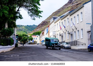 ST HELENA ISLAND, SOUTH ATLANTIC - APRIL 2 2018: Old classic car drives down picturesque Main Street St Helena past Mantis Hotel